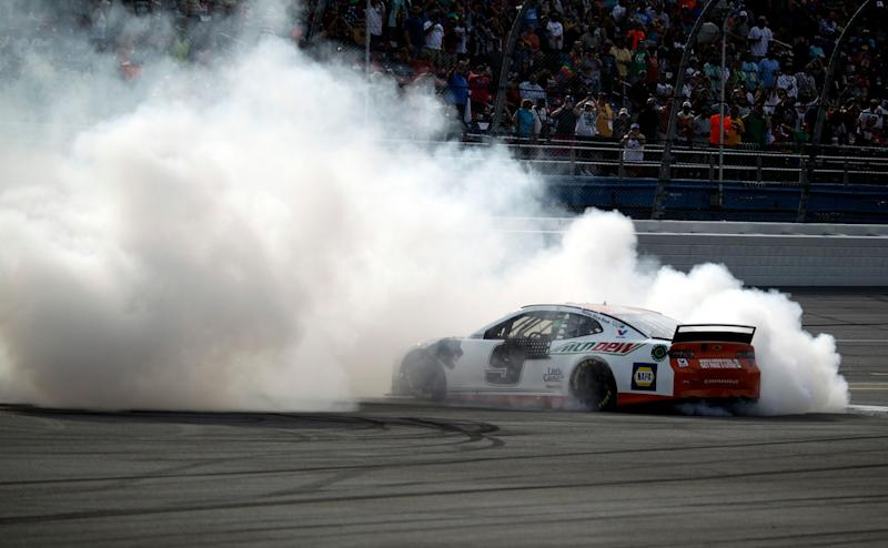 Chase Elliott (9) celebrates with a burnout at the finish line after he won a NASCAR Cup Series auto race at Talladega Superspeedway, Sunday, April 28, 2019, in Talladega, Ala. (AP Photo/Skip Williams)