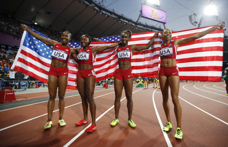 United States' women's 4 x100-meter relay team members, from left, Carmelita Jeter, Bianca Knight, Tianna Madison and Allyson Felix, celebrate their gold medal win during the athletics in the Olympic Stadium at the 2012 Summer Olympics, London, Friday, Aug. 10, 2012. The United States relay team set a new world record with a time of 40.82 seconds (AP Photo/Matt Dunham)