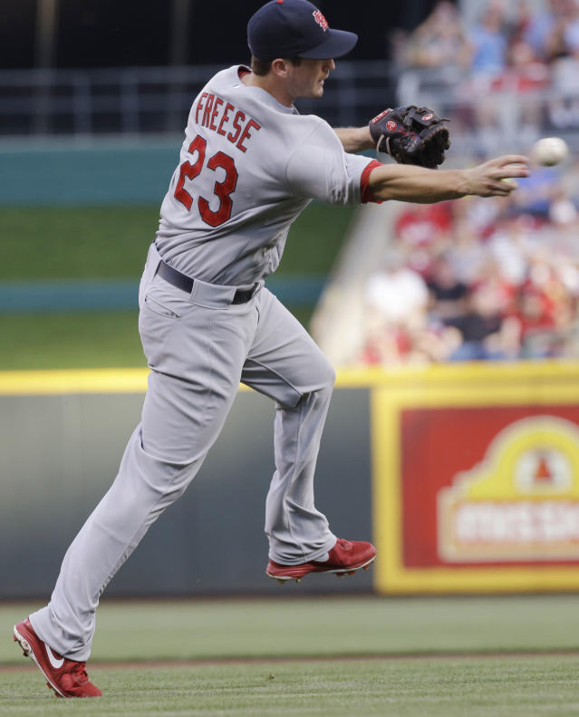 St. Louis Cardinals third baseman David Freese throws Cincinnati Reds' Brandon Phillips out at first base after fielding a ground ball in the first inning of a baseball game, Saturday, Aug. 3, 2013, in Cincinnati. (AP Photo/Al Behrman)