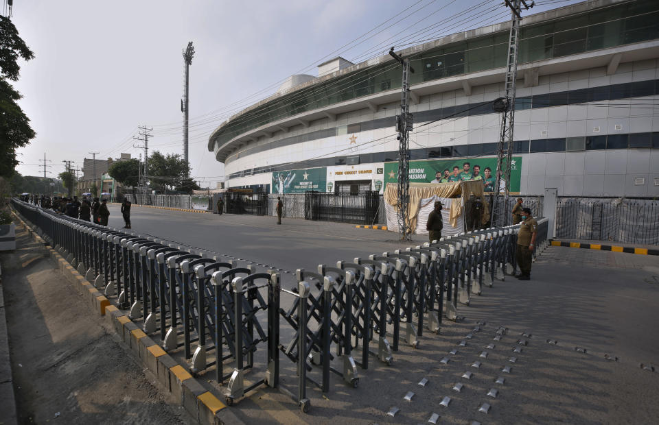 Pakistan paramilitary troops and police officer stand guard outside the Pindi Cricket Stadium following canceling of 1st one day international cricket match between Pakistan and New Zealand, in Rawalpindi, Pakistan, Friday, Sept. 17, 2021. New Zealand abandoned its cricket tour of Pakistan over security concerns that mystified the hosts, just before the Black Caps' first scheduled match in Pakistan in 18 years. (AP Photo/Anjum Naveed)