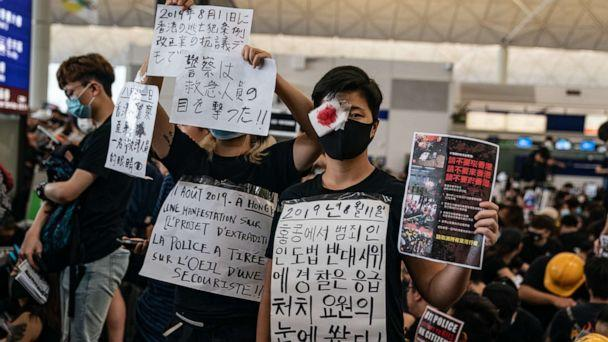 PHOTO: Protesters hold placards as they occupy the arrival hall of the Hong Kong International Airport during a demonstration on Aug. 12, 2019. (Anthony Kwan/Getty Images)