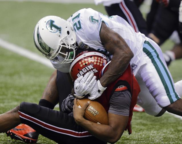 Tulane linebacker Kyle Davis (21) wraps up Louisiana-Lafayette quarterback Terrance Broadway (8) during the second half of the New Orleans Bowl NCAA college football game, Saturday, Dec. 21, 2013, in New Orleans. (AP Photo/Bill Haber)