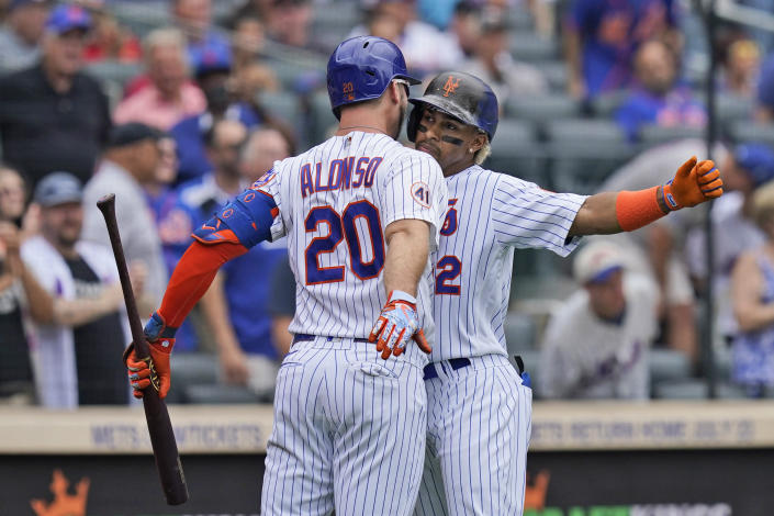 New York Mets' Francisco Lindor, right, celebrates his two-run home run with Pete Alonso during the first inning of a baseball game against the Pittsburgh Pirates at Citi Field, Sunday, July 11, 2021, in New York. (AP Photo/Seth Wenig)