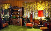 "<p>One of the more vibrant rooms in the house is known as <a href=""https://www.rollingstone.com/music/music-features/inside-elvis-presleys-legendary-man-cave-studio-248975/"" rel=""nofollow noopener"" target=""_blank"" data-ylk=""slk:Elvis's Jungle Room"" class=""link rapid-noclick-resp"">Elvis's Jungle Room</a>, however the singer simply referred to this space as the den.</p>"