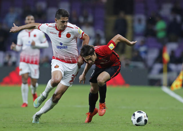 Morocco's Wydad Athletic Club Mohammed Nahiri, left, challenges Japan's Urawa Reds Tsukasa Umesaki during the Club World Cup soccer match for the fifth place between Wydad Athletic Club and Urawa Reds at the Hazza Bin Zayed stadium in Al Ain, United Arab Emirates, Tuesday, Dec. 12, 2017. (AP Photo/Hassan Ammar)