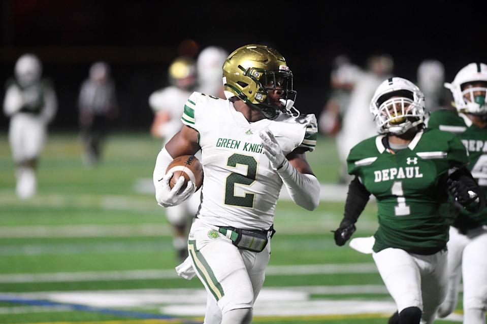St. Joseph football at DePaul in Wayne on Wednesday, November 25, 2020. SJ #2 Audric Estime on his way to scoring a touchdown in the second quarter.