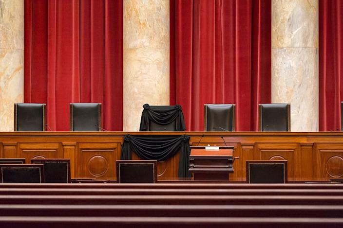 <p>FEB. 16, 2016 — Supreme Court Justice Antonin Scalia's courtroom chair is draped in black to mark his death as part of a tradition that dates to the 19th century at the Supreme Court in Washington. Scalia died Saturday at age 79. He joined the court in 1986 and was its longest-serving justice. (J. Scott Applewhite/AP) </p>