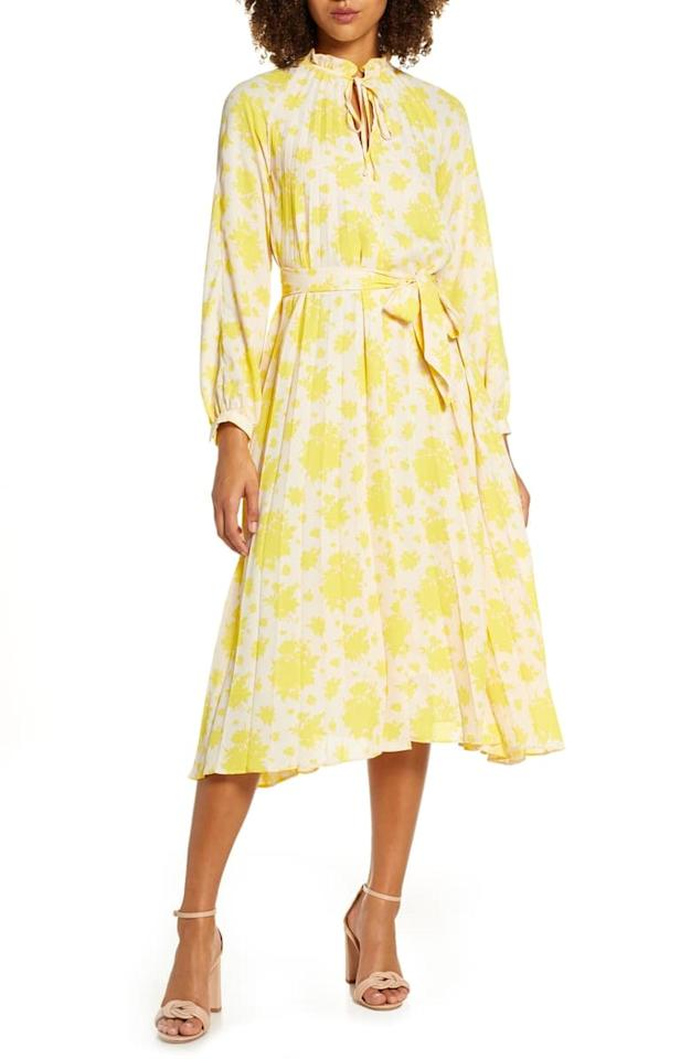 """<p>Wear this <a href=""""https://www.popsugar.com/buy/Caara-Yara-Long-Sleeve-Floral-Pleat-Midi-Dress-481691?p_name=Caara%20Yara%20Long%20Sleeve%20Floral%20Pleat%20Midi%20Dress&retailer=shop.nordstrom.com&pid=481691&price=158&evar1=fab%3Auk&evar9=46514931&evar98=https%3A%2F%2Fwww.popsugar.com%2Ffashion%2Fphoto-gallery%2F46514931%2Fimage%2F46514934%2FCaara-Yara-Long-Sleeve-Floral-Pleat-Midi-Dress&list1=shopping%2Cfall%20fashion%2Cdresses%2Cfall%2Cwedding%20guest%20dresses&prop13=api&pdata=1"""" rel=""""nofollow"""" data-shoppable-link=""""1"""" target=""""_blank"""" class=""""ga-track"""" data-ga-category=""""Related"""" data-ga-label=""""https://shop.nordstrom.com/s/caara-yara-long-sleeve-floral-pleat-midi-dress/5323342?origin=category-personalizedsort&amp;breadcrumb=Home%2FWomen%2FShop%20by%20Occasion%2FWedding%20Guest&amp;color=yellow"""" data-ga-action=""""In-Line Links"""">Caara Yara Long Sleeve Floral Pleat Midi Dress</a> ($158) beyond the <a class=""""sugar-inline-link ga-track"""" title=""""Latest photos and news for wedding"""" href=""""https://www.popsugar.co.uk/Wedding"""" target=""""_blank"""" data-ga-category=""""Related"""" data-ga-label=""""https://www.popsugar.co.uk/Wedding"""" data-ga-action=""""&lt;-related-&gt; Links"""">wedding</a>, too.</p>"""