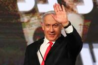 FILE PHOTO: Israeli Prime Minister Benjamin Netanyahu gestures as he delivers a speech to supporters following the announcement of exit polls in Israel's general election at his Likud party headquarters in Jerusalem