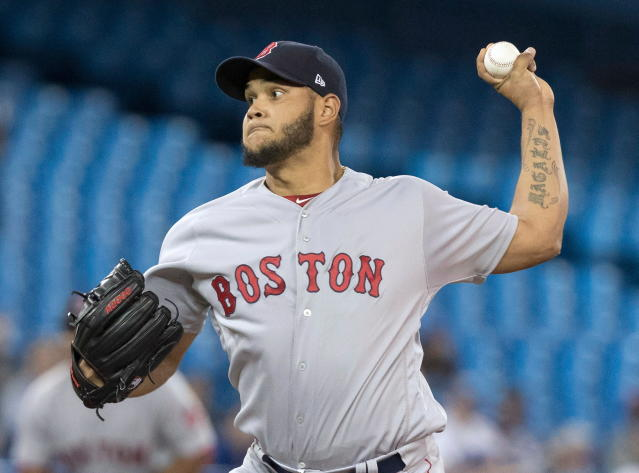 Boston Red Sox starting pitcher Eduardo Rodriguez throws against the Toronto Blue Jays in first inning baseball action in Toronto on Wednesday April 25, 2018. (Fred Thornhill/The Canadian Press via AP)