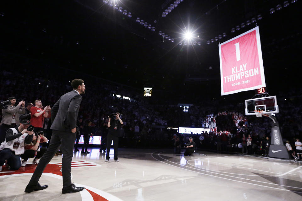 Golden State Warriors and former Washington State guard Klay Thompson watches as the school retires and lifts his jersey number to the rafters during halftime of an NCAA college basketball game between Washington State and Oregon State in Pullman, Wash., Saturday, Jan. 18, 2020. (AP Photo/Young Kwak)