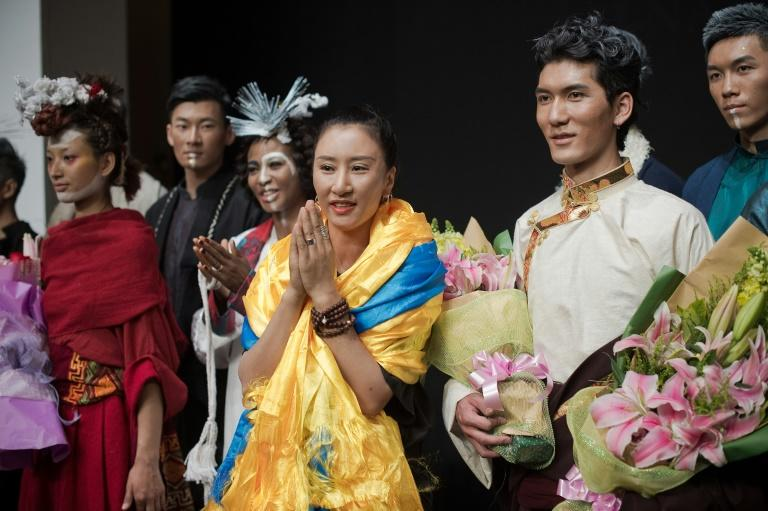 Aj-Namo (C) is the first ethnic Tibetan designer to show their work at China Fashion Week in Beijing