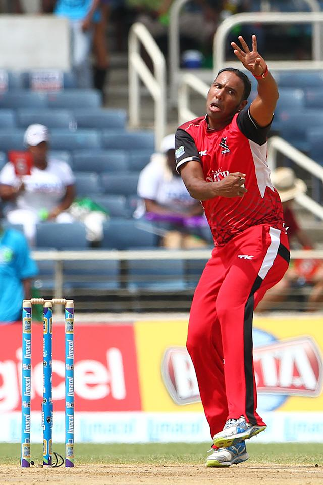 KINGSTON, JAMAICA - AUGUST 17: Trinidad and Tobago Red Steel's Samuel Badree bowls during the Eighteenth Match of the Cricket Caribbean Premier League between St. Lucia Zouks v Trinidad and Tobago Red Steel at Sabina Park on August 17, 2013 in Kingston, Jamaica. (Photo by Ashley Allen/Getty Images Latin America for CPL)