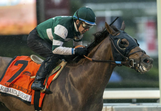 FILE - In this March 10, 2018, file photo, provided by Benoit Photo, Accelerate, with Victor Espinoza aboard, wins the Santa Anita Handicap horse race at Santa Anita Park in Arcadia, Calif. Accelerate leads the 14-horse field for the Breeders' Cup Classic, which will offer the 5-year-old a rematch against West Coast in a marquee race that's missing unbeaten Triple Crown winner Justify (Benoit Photo via AP, File)