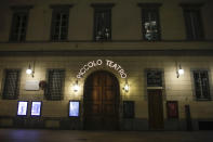 The entrance of the Piccolo theater is shut, in Milan, northern Italy, early Sunday, Oct. 25, 2020. Since the 11 p.m.-5 a.m. curfew took effect last Thursday, people can only move around during those hours for reasons of work, health or necessity. (AP Photo/Luca Bruno)