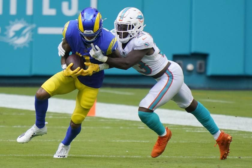 Miami Dolphins cornerback Noah Igbinoghene (23) tackles Los Angeles Rams wide receiver Robert Woods (17), during the second half of an NFL football game, Sunday, Nov. 1, 2020, in Miami Gardens, Fla. The Dolphins defeated the Rams 28-17. (AP Photo/Wilfredo Lee)
