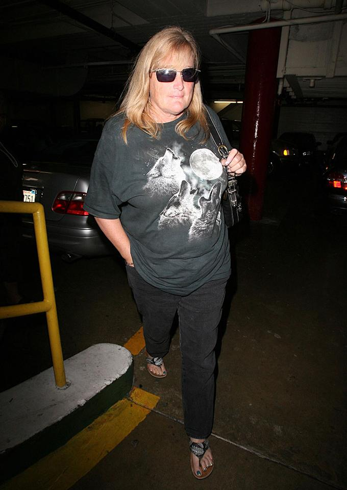 """Michael Jackson's ex Debbie Rowe never claimed to be a fashionista, but there's just no excuse for rocking that infamous """"Three Wolf Moon"""" T-shirt in public. London Ent/<a href=""""http://www.splashnewsonline.com"""" target=""""new"""">Splash News</a> - July 27, 2009"""