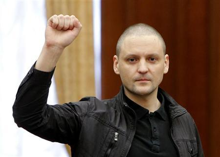 Opposition leader Udaltsov gestures during a court hearing in Moscow