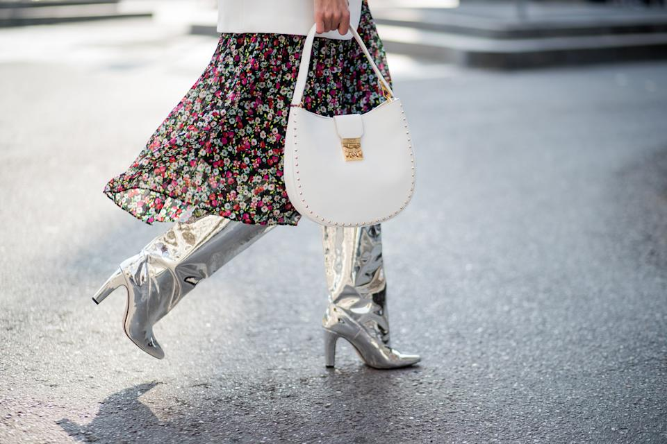MILAN, ITALY - FEBRUARY 21: Alexandra Lapp wearing a long flower dress from H&M, silver shiny boots by H&M, a long white blazer from Zara, a lacquer waist belt in white and black from Balmain, a white Patricia Hobo bag with studs and sunglasses from Le Specs in pink seen during Milan Fashion Week Fall/Winter 2018/19 on February 21, 2018 in Milan, Italy. (Photo by Christian Vierig/Getty Images)