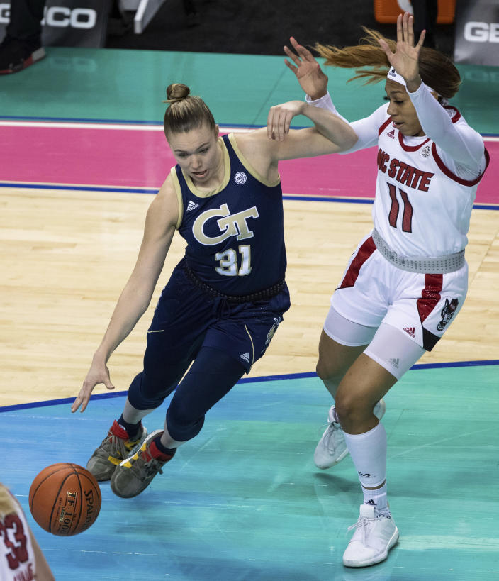 Georgia Tech's Lotta-Maj Lahtinen (31) drives as North Carolina State's Jakia Brown-Turner (11) defends during an NCAA college basketball game in the semifinals of Atlantic Coast Conference tournament in Greensboro, N.C., Saturday, March 6, 2021. (AP Photo/Ben McKeown)