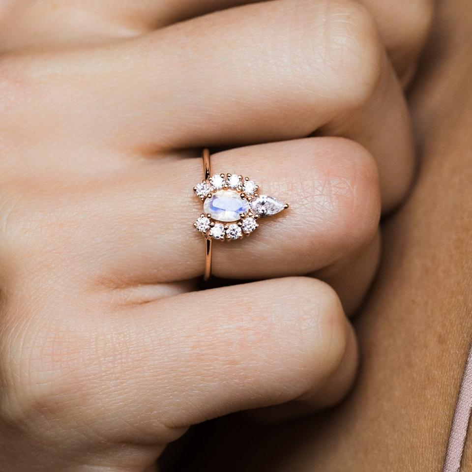 """<p>There's no doubt they'll make a statement wearing this <a href=""""https://www.popsugar.com/buy/Moonstone-Diamond-Princess-Crown-Ring-531213?p_name=Moonstone%20and%20Diamond%20Princess%20Crown%20Ring&retailer=localeclectic.com&pid=531213&price=99&evar1=fab%3Aus&evar9=44555978&evar98=https%3A%2F%2Fwww.popsugar.com%2Fphoto-gallery%2F44555978%2Fimage%2F47011762%2FMoonstone-Diamond-Princess-Crown-Ring&list1=wedding%2Cjewelry%2Crose%20gold%2Cengagement%20rings&prop13=api&pdata=1"""" rel=""""nofollow"""" data-shoppable-link=""""1"""" target=""""_blank"""" class=""""ga-track"""" data-ga-category=""""Related"""" data-ga-label=""""https://www.localeclectic.com/collections/rings/products/moonstone-diamond-princess-crown-ring"""" data-ga-action=""""In-Line Links"""">Moonstone and Diamond Princess Crown Ring</a> ($99).</p>"""