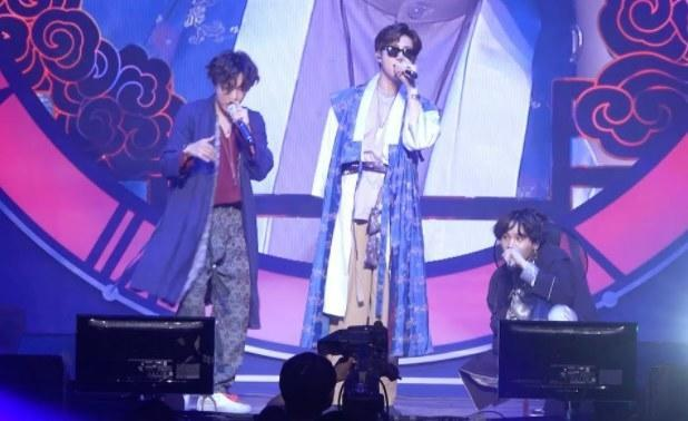 The rap line of BTS wear hanbok and perform on stage
