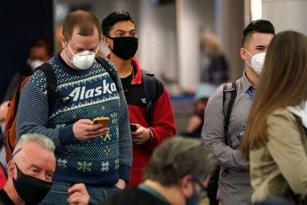 PHOTO: Passengers wait to board the first Alaska Airlines passenger flight on a Boeing 737-9 Max airplane, March 1, 2021, for a flight to San Diego from Seattle-Tacoma International Airport in Seattle. (Ted S. Warren/AP)