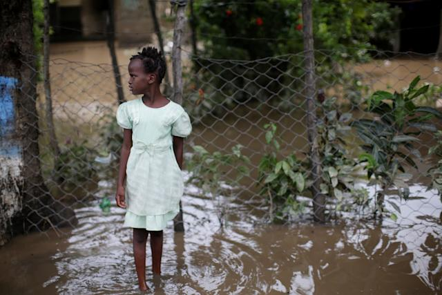 A girl stands in a flooded area in Fort Liberte, Haiti