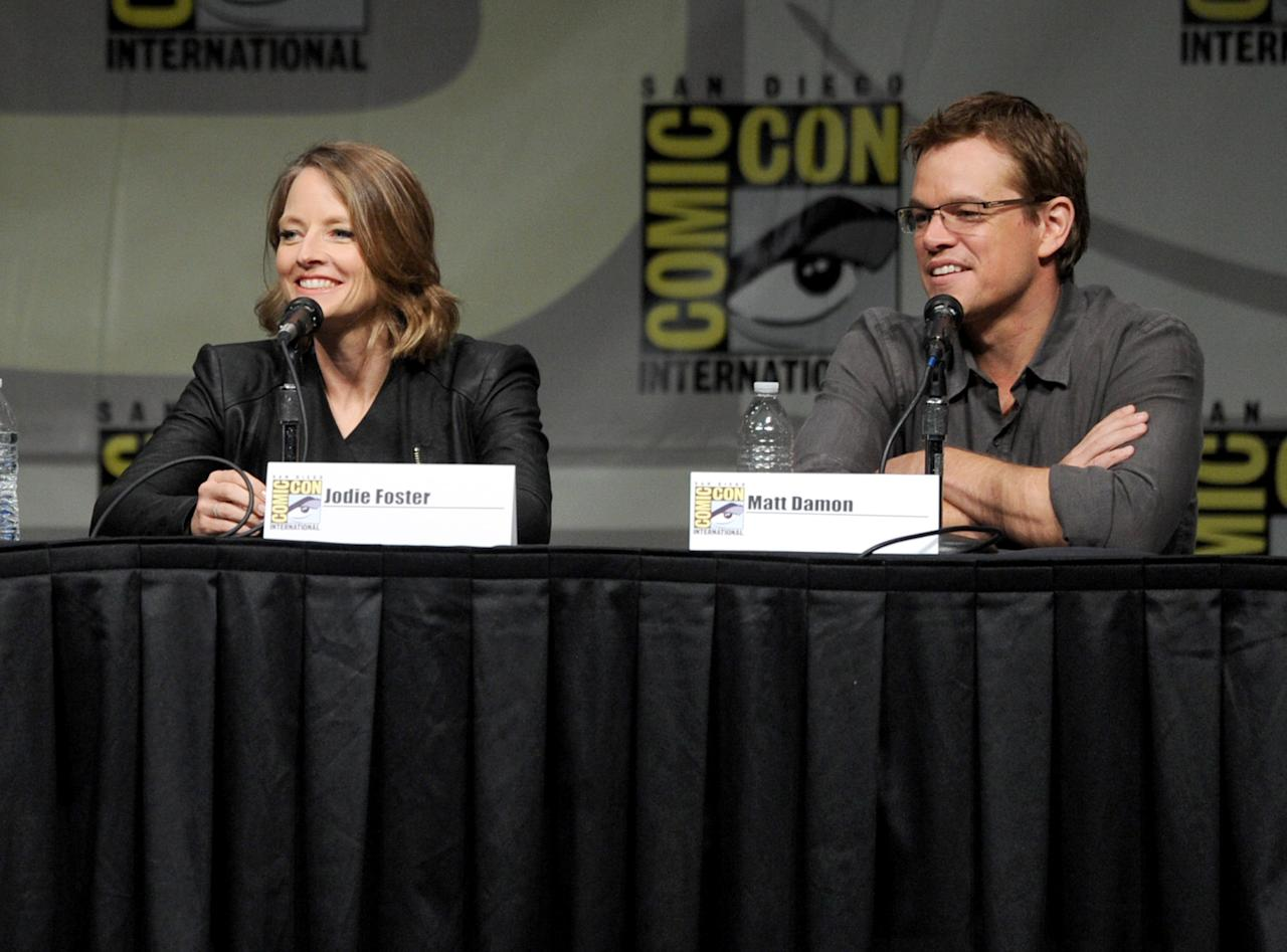 "SAN DIEGO, CA - JULY 13:  Actress Jodie Foster (L) and actor Matt Damon speak during Sony's ""Eylsium"" panel during Comic-Con International 2012 at San Diego Convention Center on July 13, 2012 in San Diego, California.  (Photo by Kevin Winter/Getty Images)"