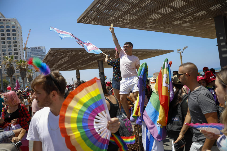 People participate in the annual Pride Parade, in Tel Aviv, Israel, Friday, June 25, 2021. Thousands of people attended the parade in one of the largest public gatherings held in Israel since the onset of the coronavirus pandemic. (AP Photo/Ariel Schalit)
