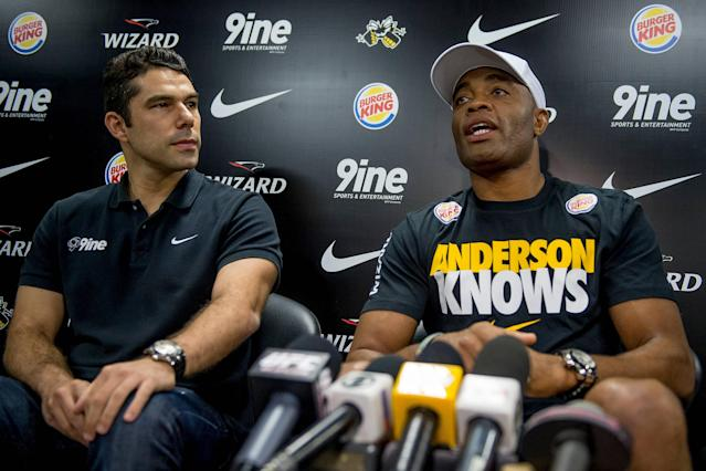 RIO DE JANEIRO, BRAZIL - JUNE 12: Anderson Silva (right) with your manager Marcus Buaiz speaks during a press conference for UFC 162 at X-Gym on June 12, 2013 in Rio de Janeiro, Brazil. (Photo by Buda Mendes/Getty Images)