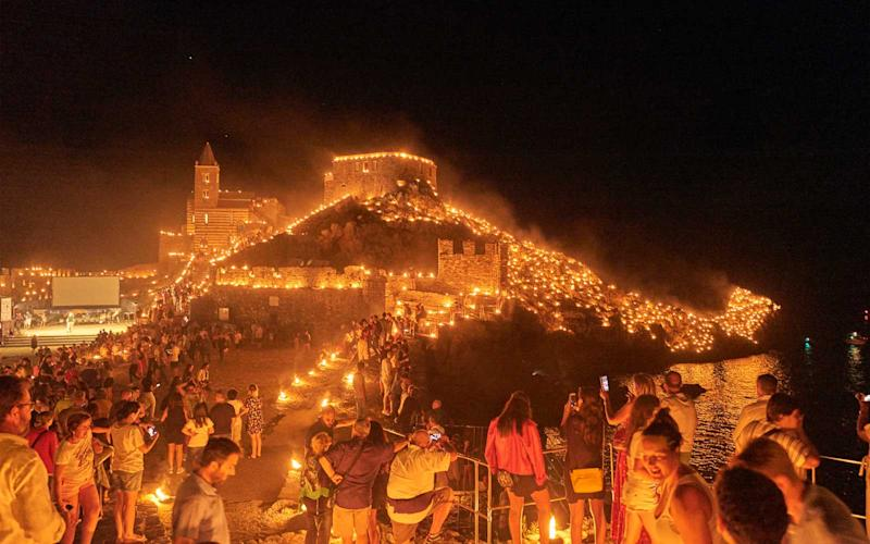 View of the Old Town of Porto Venere, lit with candles for Madonna Bianca. | Chiara Goia
