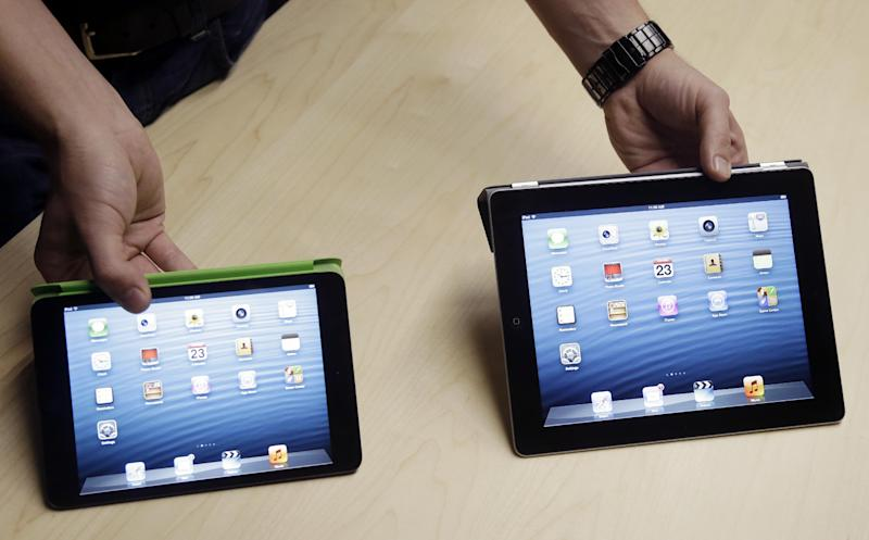 The iPad Mini, at left, is shown next to the 4th Generation iPad in San Jose, Calif., Tuesday, Oct. 23, 2012. Apple Inc. is refusing to compete on price with its rivals in the tablet market, it's pricing its new, smaller iPad well above the competition. On Tuesday, the company revealed the iPad Mini, with a screen that's about two-thirds the size of the full-size model, and said it will cost $329 and up. (AP Photo/Marcio Jose Sanchez)
