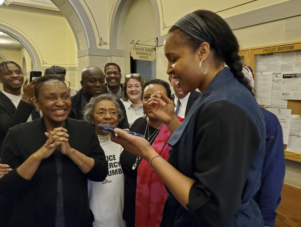 """FILE - In this March 9, 2020, file photo, Jefferson City, Mo., native Maya Moore, right, calls Jonathan Irons as supporters react in Jefferson City, Mo., after Cole County Judge Dan Green overturned Irons' convictions in a 1997 burglary and assault case. Moore left the WNBA in 2019 to help her now husband Jonathan Irons get his conviction overturned and win his release from prison. Moore, 32, remains non-committal to returning to the WNBA. A documentary of their story — """"Breakaway"""" — that was produced by Robin Roberts will air next week on ESPN. (Jeff Haldiman/The Jefferson City News-Tribune via AP, File)"""