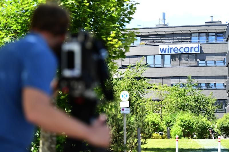 ASCHHEIM, GERMANY - JULY 01: Media gathers outside the corporate headquarters of payments processor Wirecard during a raid by investigators on July 1, 2020 in Aschheim, Germany. According to media reports state investigators are searching Wirecard offices as well as the residence in Vienna of Wirecard CEO Markus Braun. The company recently declared bankruptcy and its executives are being investigated for fraud. (Photo by Lennart Preiss/Getty Images)