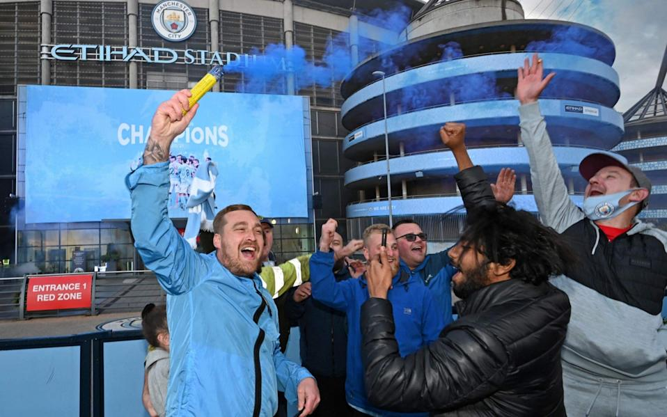 City fans enjoy their Title win outside the Etihad - AFP