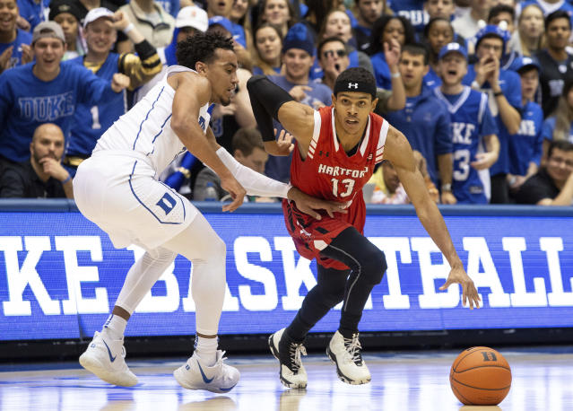 Hartford's J.R. Lynch (13) drives against Duke's Tre Jones, left, during the first half of an NCAA college basketball game in Durham, N.C., Wednesday, Dec. 5, 2018. (AP Photo/Ben McKeown)