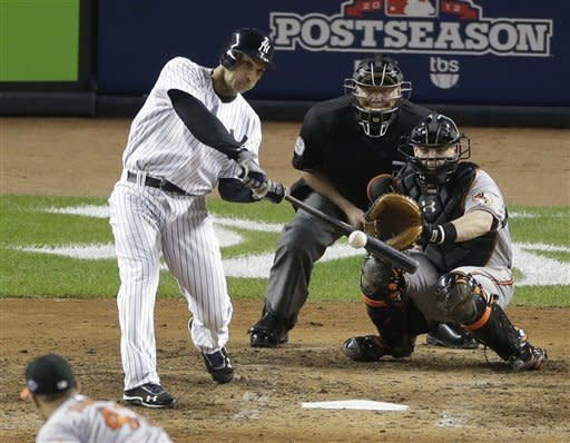 New York Yankees' Raul Ibanez hits a solo home run to tie the game in the ninth inning in Game 3 of the American League division baseball series against the Baltimore Orioles on Wednesday, Oct. 10, 2012, in New York. The Orioles catcher is Matt Wieters and the umpire is Brian Gorman. (AP Photo/Peter Morgan)