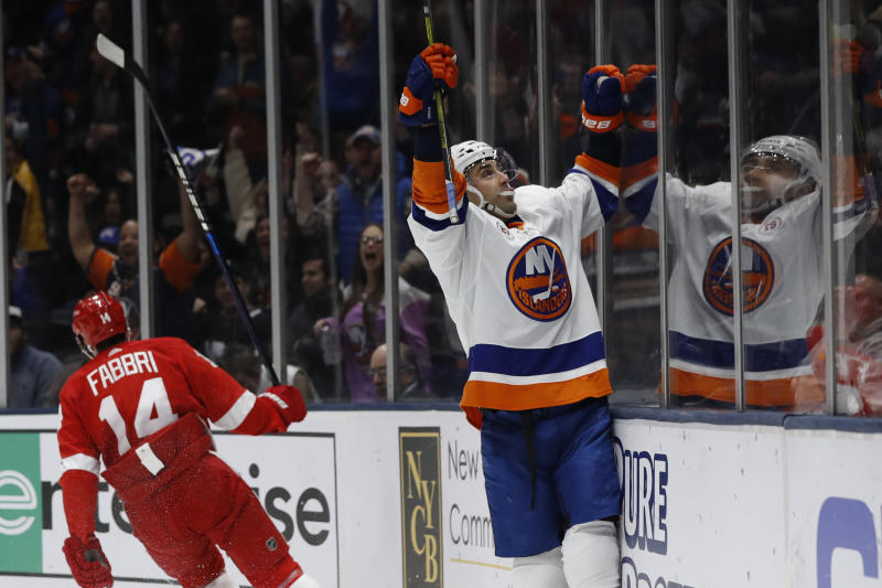New York Islanders right wing Jordan Eberle reacts toward the crowd after scoring his second goal of the night, during the second period of the team's NHL hockey gam against the Detroit Red Wings ,as Red Wings center Robby Fabbri (14) skates away, Friday, Feb. 21, 2020, in Uniondale, N.Y. (AP Photo/Kathy Willens)