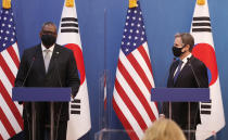 U.S. Defense Secretary Lloyd Austin, left, speaks as U.S. Secretary of State Antony Blinken, right, listens during a joint press conference with South Korean Foreign Minister Chung Eui-yong, and South Korean Defense Minister Suh Wook, at the Foreign Ministry in Seoul, South Korea, Thursday, March 18, 2021. (AP Photo/Lee Jin-man, Pool)