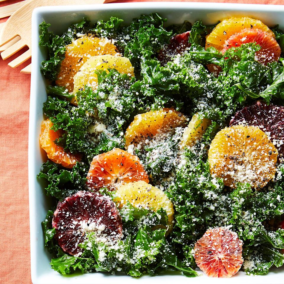 <p>Massaging the kale is well worth the effort because the process quickly softens the leaves for a tender bite. We've used green curly kale here, but red kale would also give this salad a lovely appearance. For an extra burst of citrus flavor, garnish each serving with additional lemon zest.</p>