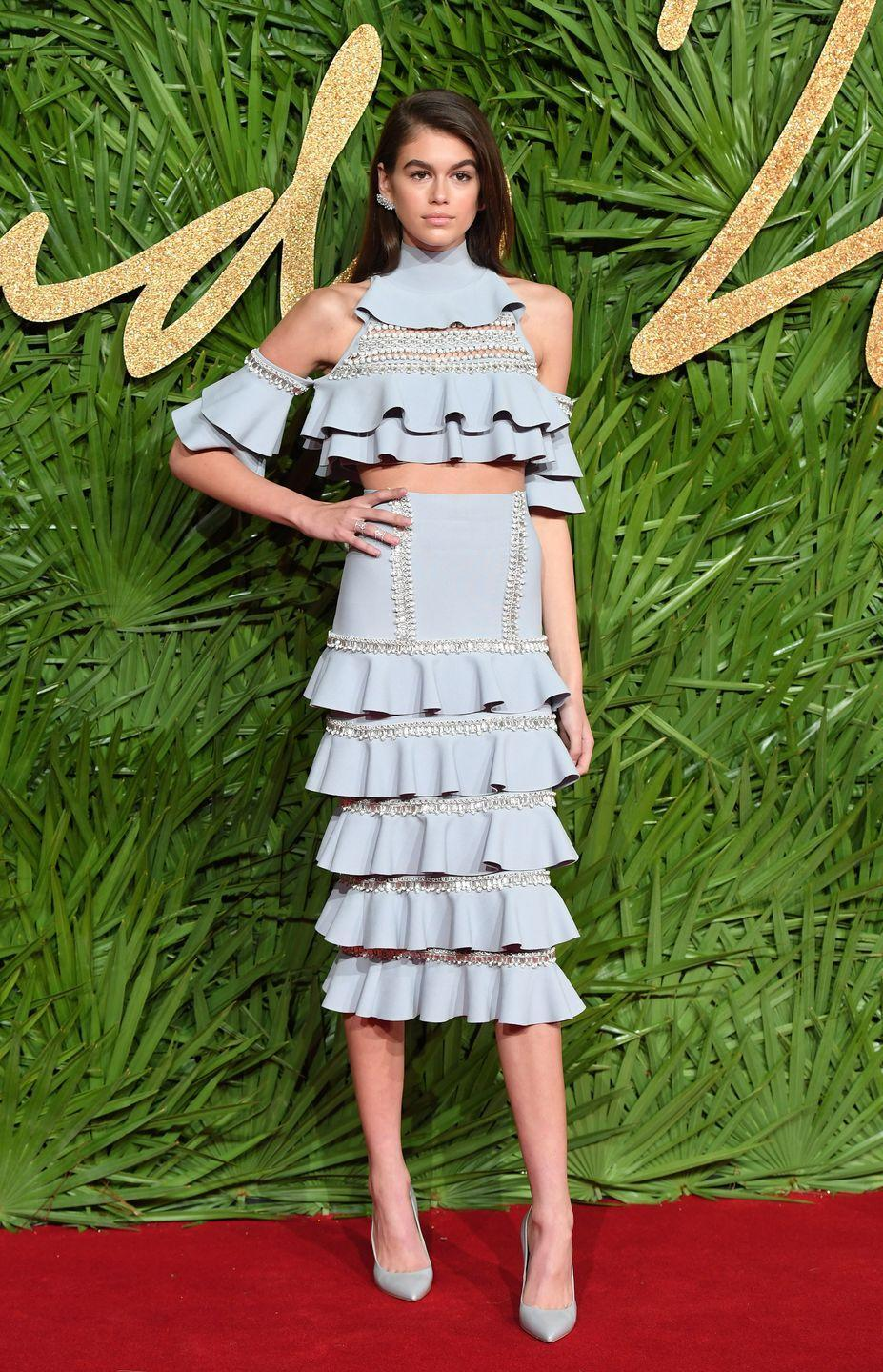 <p>Kaia Gerber attends the Fashion Awards 2017 In Partnership With Swarovski wearing a pearl-embellished blue frill two-piece by Ralph & Russo</p>