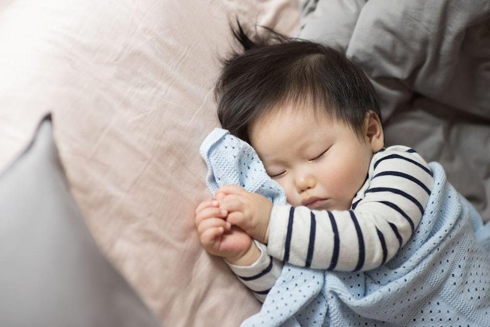 """<p>The trend of not disturbing a sleeping baby has been around for a very long time, and at first thought, it makes sense: Babies need rest, so why would you wake them up? But according to Dr. Harvey Karp, author of <em><a href=""""https://www.amazon.com/Happiest-Toddler-Block-Cooperative-Four-Year-Old/dp/0553384422"""" rel=""""nofollow noopener"""" target=""""_blank"""" data-ylk=""""slk:Happiest Toddler on the Block"""" class=""""link rapid-noclick-resp"""">Happiest Toddler on the Block </a></em>and <em><a href=""""https://www.amazon.com/Happiest-Baby-Block-Harvey-Karp/dp/0553381466"""" rel=""""nofollow noopener"""" target=""""_blank"""" data-ylk=""""slk:Happiest Baby on the Block"""" class=""""link rapid-noclick-resp"""">Happiest Baby on the Block</a></em>, this is actually a good habit to get into when you're putting your baby down to sleep. </p><p>""""Slightly jostling a baby when he or she is placed down is called the wake-and-sleep technique,"""" Dr. Karp tells Woman's Day. """"It is the first step in helping babies develop the ability to drift back into sleep when a noise or hiccup accidentally rouses them in the middle of the night. So, it's actually good to wake sleeping babies when you place them down to sleep."""" </p>"""