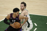 Philadelphia 76ers' Tobias Harris (12) drives to the basket against Milwaukee Bucks' Pat Connaughton during the second half of an NBA basketball game Thursday, April 22, 2021, in Milwaukee. (AP Photo/Aaron Gash)