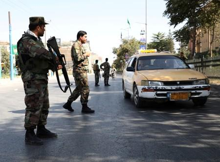 Afghan National Army (ANA) soldiers stand guard at a check point in Kabul, Afghanistan