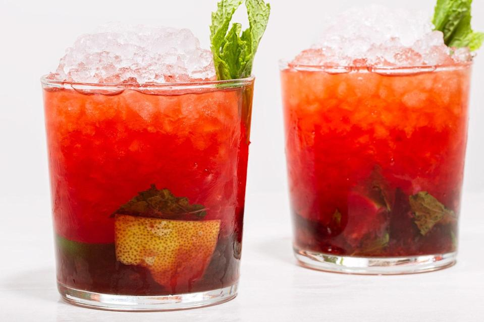 """In this rum-centric take on the Whiskey Smash, the spirit mingles with fresh fruit and a helping of mint leaves and sprigs for garnish. <a href=""""https://www.epicurious.com/recipes/food/views/the-cherry-bomb-56389793?mbid=synd_yahoo_rss"""" rel=""""nofollow noopener"""" target=""""_blank"""" data-ylk=""""slk:See recipe."""" class=""""link rapid-noclick-resp"""">See recipe.</a>"""