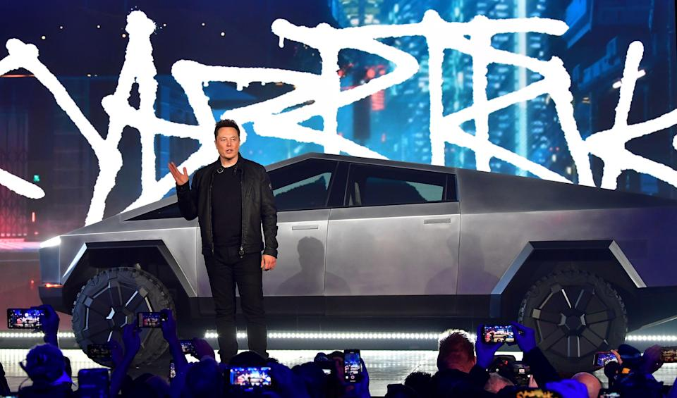 <p>Tesla co-founder and CEO Elon Musk introduces the newly unveiled all-electric battery-powered Tesla Cybertruck at Tesla Design Center in Hawthorne, California on November 21, 2019</p> (Photo by FREDERIC J. BROWN/AFP via Getty Images)