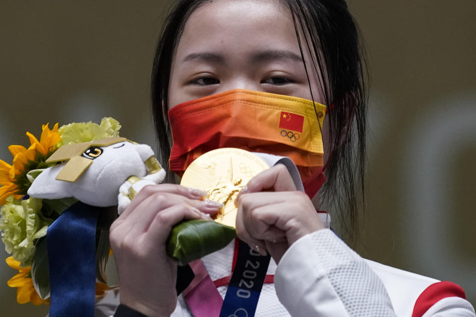 Yang Qian, of China, reacts after winning the gold medal in the women's 10-meter air rifle at the Asaka Shooting Range in the 2020 Summer Olympics, Saturday, July 24, 2021, in Tokyo, Japan. (AP Photo/Alex Brandon)