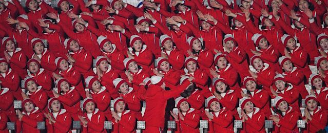 <p>North Korean cheerleaders wave ahead of the opening ceremony of the Pyeongchang 2018 Winter Olympic Games at the Pyeongchang Stadium on February 9, 2018. </p>