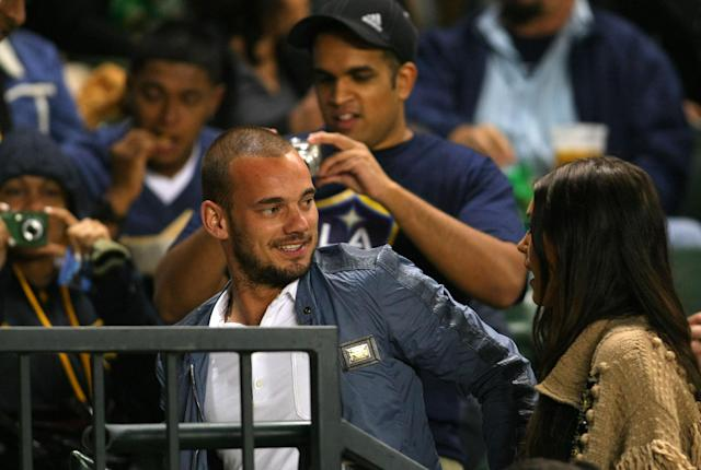CARSON, CA - JUNE 03: Dutch footballer Wesley Sneijder and wife Yolanthe Cabau attend the MLS match between D.C. United and the Los Angeles Galaxy at The Home Depot Center on June 3, 2011 in Carson, California. United and the Galaxy played to a 0-0 draw. (Photo by Victor Decolongon/Getty Images)